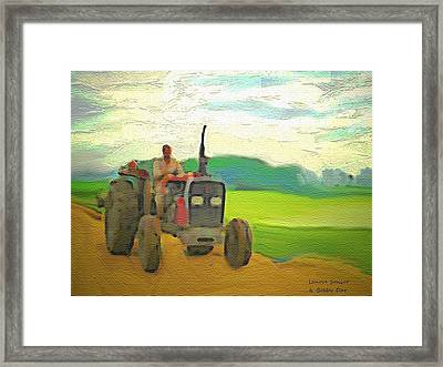 Man On A Tractor Framed Print