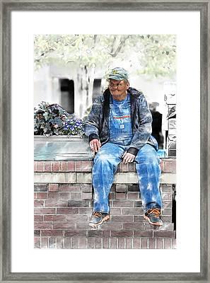 Man On A Wall Framed Print by John Haldane