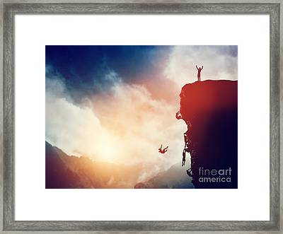 Man On The Peak Of Mountain Against Others Struggling To Climb Framed Print