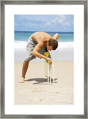 Man Playing Beach Cricket Framed Print