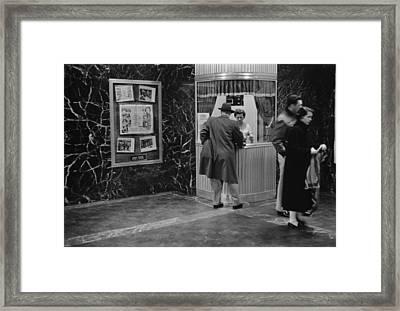 Man Purchasing A Movie Ticket Framed Print by Everett