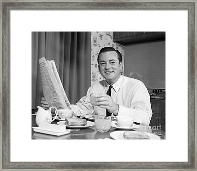 Man Reading Paper At Breakfast, C.1960s Framed Print