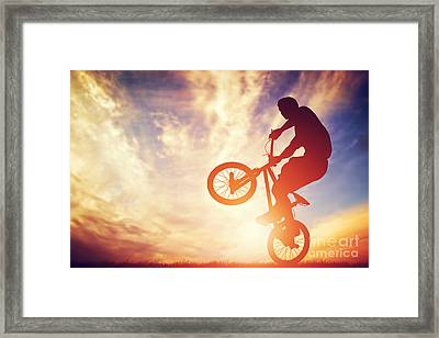 Man Riding A Bmx Bike Performing A Trick Against Sunset Sky Framed Print