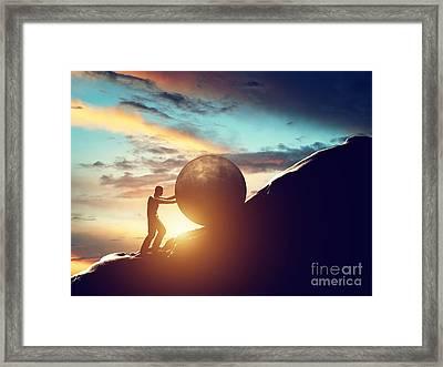 Man Rolling Huge Concrete Ball Up Hill Framed Print
