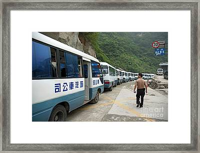 Man Searching Among A Row Of Tourist Buses Parked On Mount Hua Framed Print by Sami Sarkis