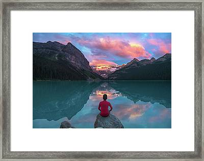 Framed Print featuring the photograph Man Sit On Rock Watching Lake Louise Morning Clouds With Reflect by William Lee