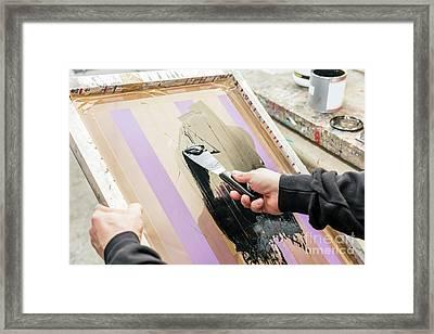 Man Squeegeeing Silkscreen In A Workshop. Serigraphy Framed Print by Michal Bednarek