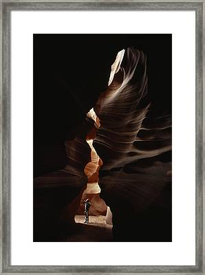 Man Standing In Sunlight In A Narrow Framed Print by Paul Chesley
