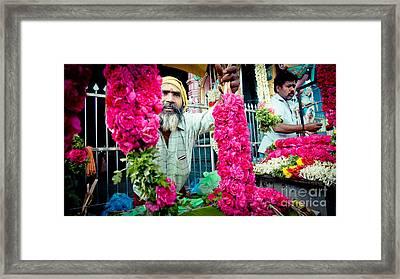 Man With Flowers Near The Temple Kerala Yatra 2016 Yantra Framed Print by Raimond Klavins