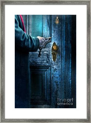 Man With Keys At Door Framed Print by Jill Battaglia