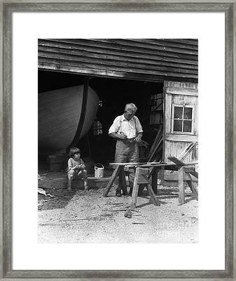 Man Woodworking While Boy Looks On Framed Print