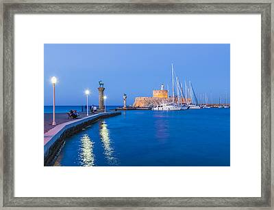 Mandraki Harbour At Night Framed Print by Werner Dieterich