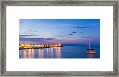 Mandraki Harbour At Twilight Framed Print by Werner Dieterich