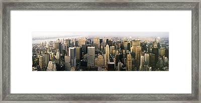 Manhattan Skyline - New York City Framed Print by Daniel Hagerman