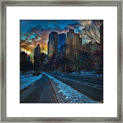 Manhattan Sunset Framed Print by Chris Lord