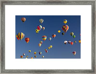 Many Vividly Colored Hot Air Balloons Framed Print by Ralph Lee Hopkins