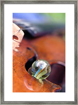 Marble On Violin Framed Print