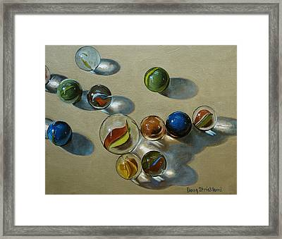 Marbles Framed Print by Doug Strickland