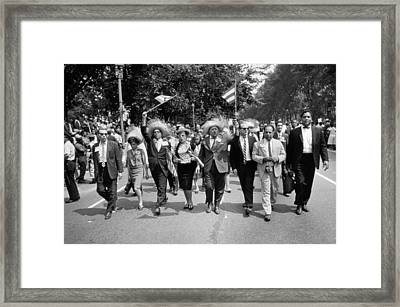 Marchers Wearing Hats Carry Puerto Rican Flags Down Constitution Avenue Framed Print by Nat Herz