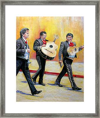 Marching Mariachi Framed Print by Carole Haslock