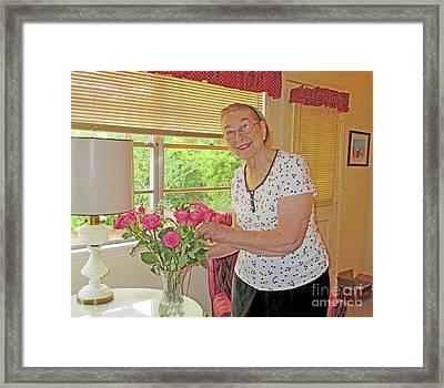 Marion Loves Roses Framed Print by Fred Jinkins