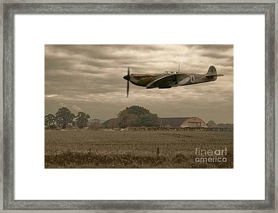 Mark 1 Supermarine Spitfire Flying Past Hanger Framed Print