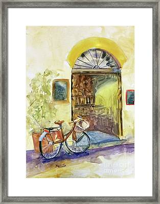 Market Day In Lucca Framed Print by Bonnie Rinier