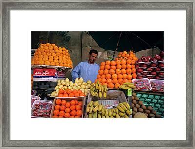 Market Vendor Selling Fruit In A Bazaar Framed Print by Sami Sarkis