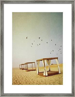 Massage Booths On A Foggy Beach Framed Print by Carlos Caetano