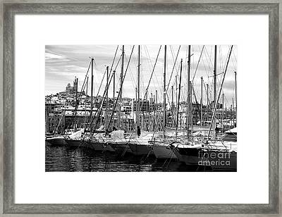 Masts In The Harbor Framed Print by John Rizzuto