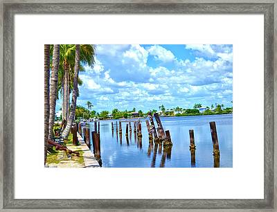 Framed Print featuring the photograph Matlacha Totem Poles by Timothy Lowry