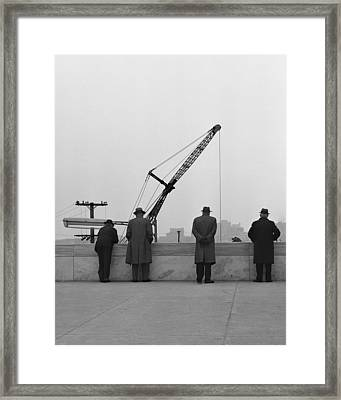 Men Watching Framed Print by Clyde Replogle