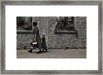 Menonite Woman And Child Framed Print
