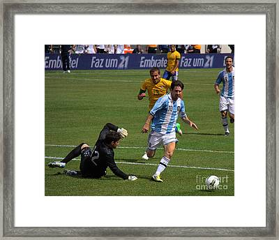 Messi Breaking Ankles Framed Print by Lee Dos Santos