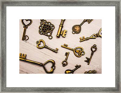 Metal Keys Of Different Size On Wooden Table Framed Print by Jorgo Photography - Wall Art Gallery