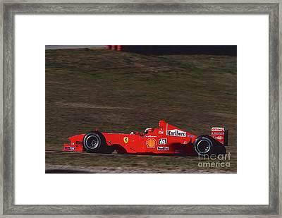 Michael Schumacher. 1999 Pre Season Test Framed Print by Oleg Konin
