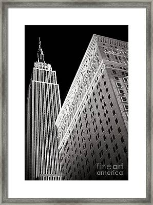 Framed Print featuring the photograph Midtown Empire by John Rizzuto
