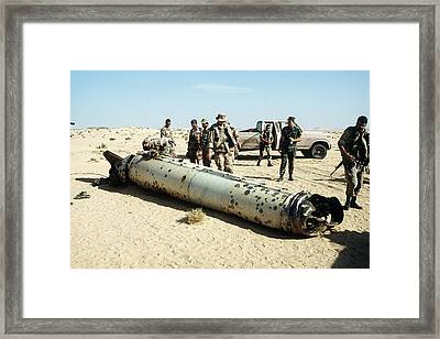 Military Personnel Examine A Scud Framed Print
