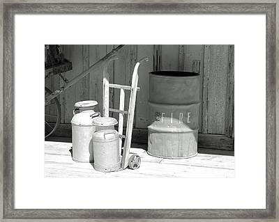 Milk Cans And Fire Barrel Framed Print by Troy Montemayor