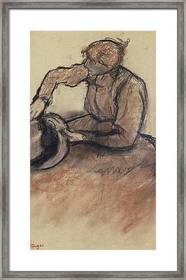 Milliner Trimming A Hat Framed Print