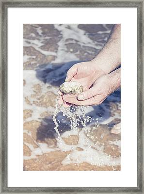 Mineralogy Collector Washing A Pumice Stone Sample Framed Print by Jorgo Photography - Wall Art Gallery