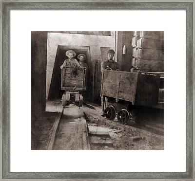 Miners Pushing Ore Carts Framed Print by Everett