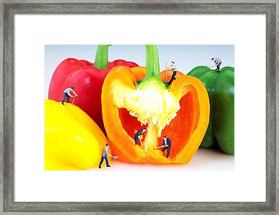 Mining In Colorful Peppers Framed Print by Paul Ge