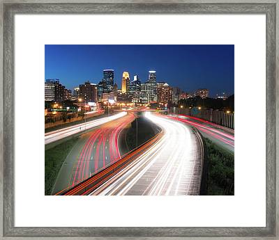 Minneapolis Skyline And Traffic Flow Framed Print by Jim Hughes