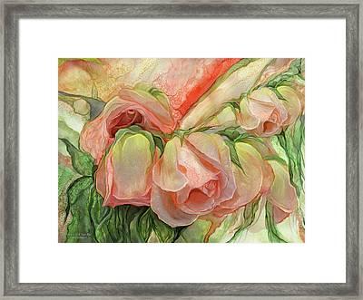 Miracle Of A Rose Bud - Peach Framed Print by Carol Cavalaris