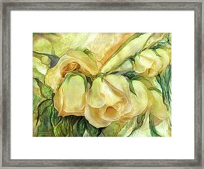 Miracle Of A Rose Bud - Yellow Framed Print by Carol Cavalaris