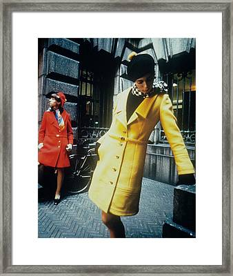 Models In Colorful Coats Framed Print by David McCabe