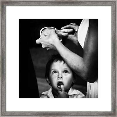 Mom, Dad, What's Going On?? Framed Print by Santiago Trupkin