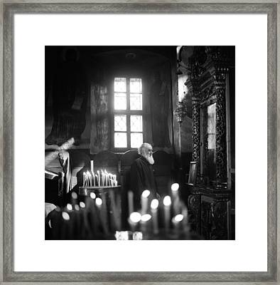 Monk And Candles Framed Print by Emanuel Tanjala