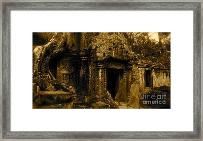 Monks Leaving Angkor Wat Framed Print